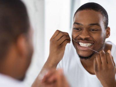 Dental Flossing Mistakes - Man Flossing
